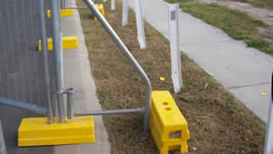 A portable fence bracing is installed on the fence panels.