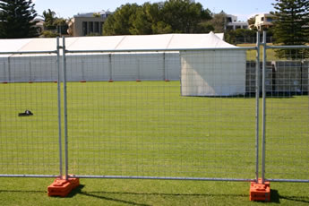 Three welded portable fences are installed on the grassland.