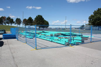 Canada portable fences are installed on the ground of the construction sites.