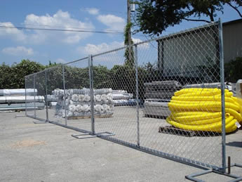 Chain link portable fences are installed in the factory and several equipments in it.