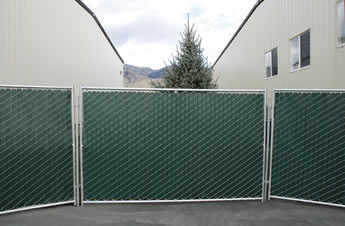 Chain link portable fence slats are installed in the portable fence mesh.