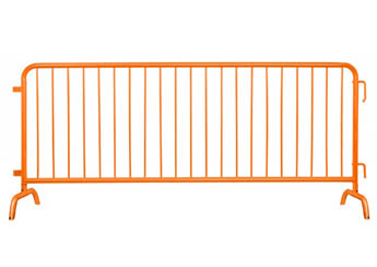 A piece of orange powder coated crowd control barrier with bridge feet.