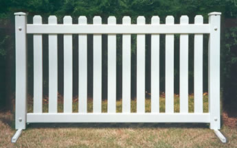 A piece of picket event portable fence on the grassland.