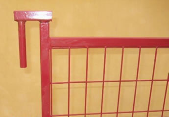 A red top coupler with round tubular legs are installed on the fence panel.