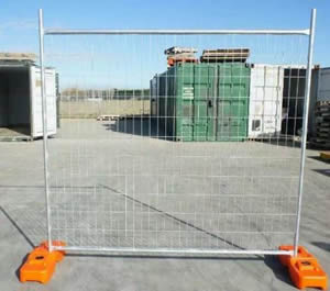 A portable fence with orange base on the ground.