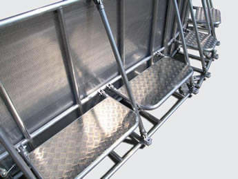 Four stage barriers with anti-slip checker plate foot board.