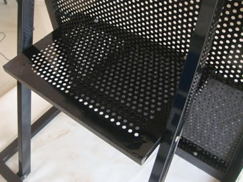 A piece of stage barrier with perforated foot board.